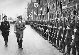 Hitler Marching Beside Troops